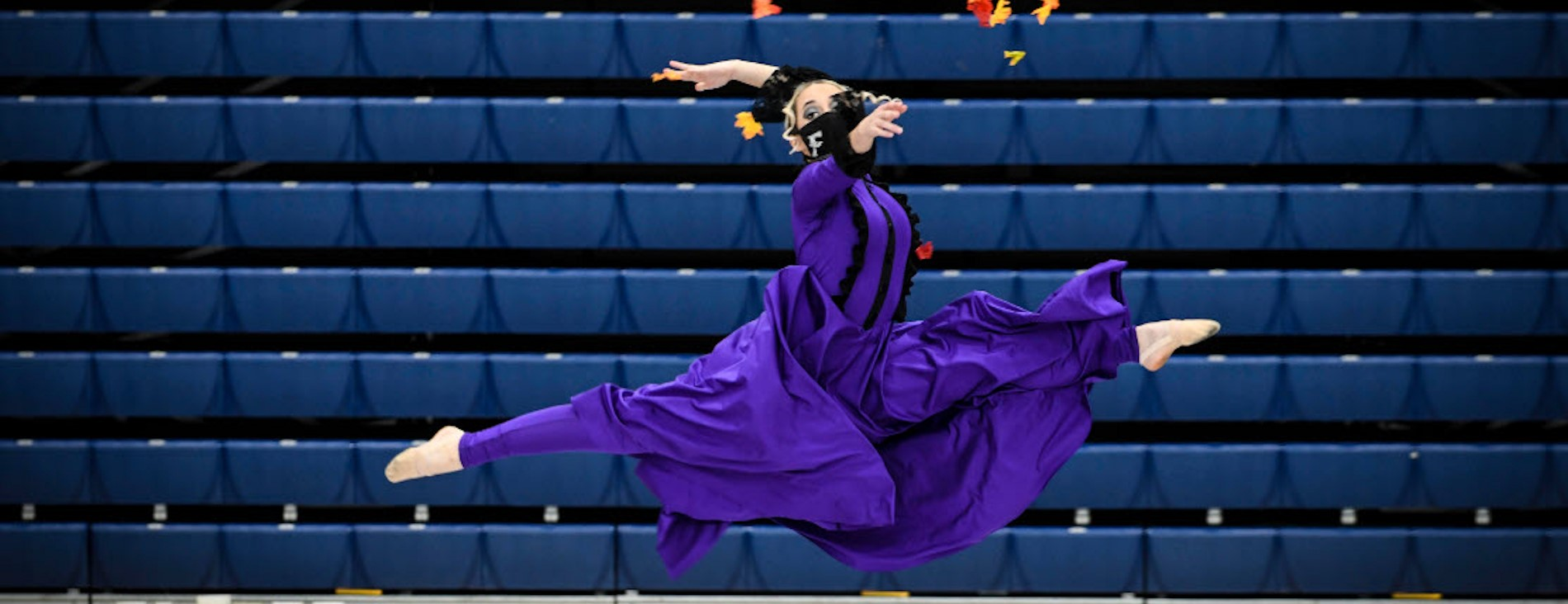 Olivia O., a members of Fairmont High School's Color Guard, performs her routine during a competition at Trent Arena.