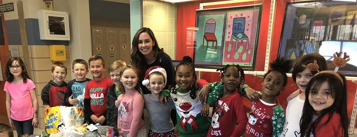 Second Graders Coordinate Holiday Donations to SICSA